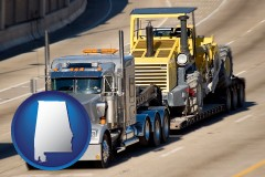 alabama map icon and a semi-truck hauling heavy construction equipment