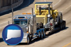 connecticut map icon and a semi-truck hauling heavy construction equipment