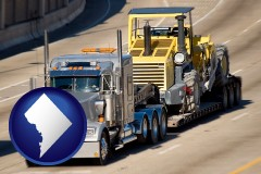 washington-dc map icon and a semi-truck hauling heavy construction equipment