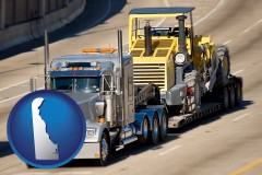 delaware map icon and a semi-truck hauling heavy construction equipment