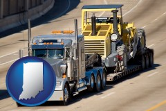 indiana map icon and a semi-truck hauling heavy construction equipment