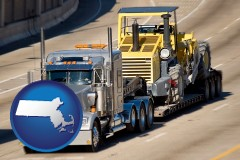 massachusetts map icon and a semi-truck hauling heavy construction equipment