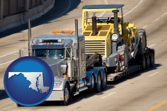 maryland map icon and a semi-truck hauling heavy construction equipment