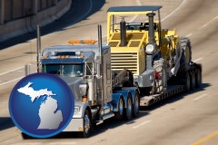 michigan map icon and a semi-truck hauling heavy construction equipment