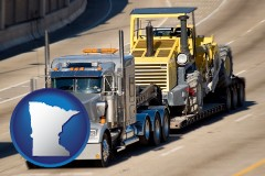 minnesota map icon and a semi-truck hauling heavy construction equipment