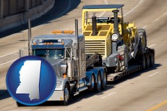 mississippi map icon and a semi-truck hauling heavy construction equipment