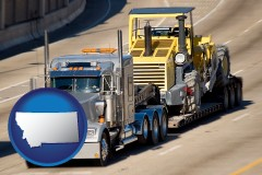 montana map icon and a semi-truck hauling heavy construction equipment