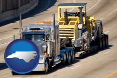 north-carolina map icon and a semi-truck hauling heavy construction equipment