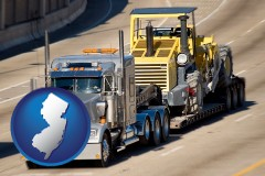 new-jersey map icon and a semi-truck hauling heavy construction equipment