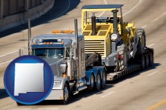 new-mexico map icon and a semi-truck hauling heavy construction equipment