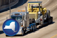 new-york map icon and a semi-truck hauling heavy construction equipment