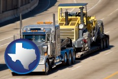 texas map icon and a semi-truck hauling heavy construction equipment