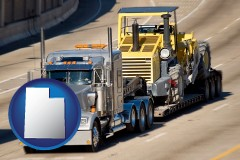 utah map icon and a semi-truck hauling heavy construction equipment